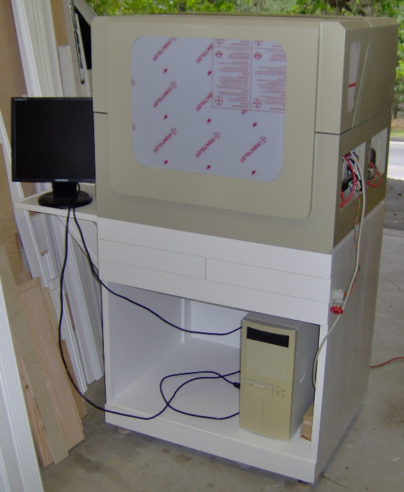 CNC machine on its cabinet